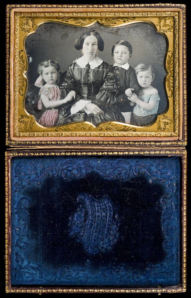 [Woman with three children]