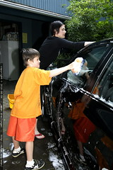 mother and son washing the car