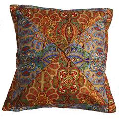 orange(0.0), furniture(0.0), bed sheet(0.0), design(0.0), art(1.0), textile(1.0), pillow(1.0), throw pillow(1.0), paisley(1.0), cushion(1.0),