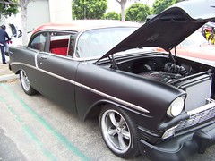 chevrolet bel air(0.0), automobile(1.0), automotive exterior(1.0), 1957 chevrolet(1.0), vehicle(1.0), compact car(1.0), sedan(1.0), land vehicle(1.0), luxury vehicle(1.0), coupã©(1.0),