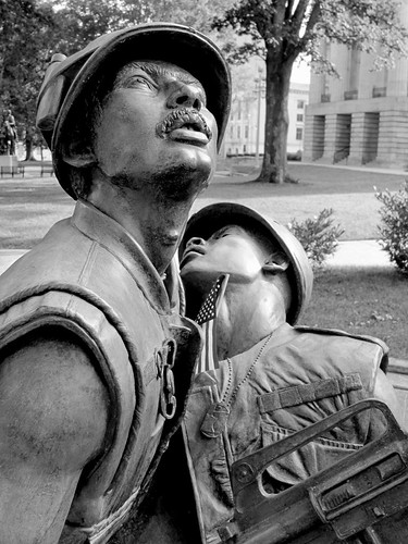 blackandwhite bw sculpture infantry bronze shoes war pants faces wounded knife expressions statues northcarolina raleigh nb equipment soldiers guns canteen grenade emotions figures bandage carry weapons memorialday colfax injured sculpt intheround vietnamveterans abbegodwin