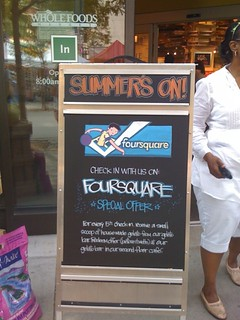 Whole Foods running @foursquare blackboard ads outside their stores = amazing