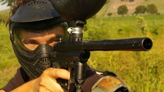 soldier(0.0), contact sport(0.0), shooting sport(0.0), combat sport(0.0), team sport(0.0), camera operator(0.0), military(0.0), individual sports(1.0), sports(1.0), recreation(1.0), outdoor recreation(1.0), shooting range(1.0), games(1.0), firearm(1.0), gun(1.0), paintball(1.0),