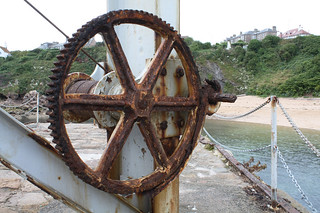 Rusty cog on the derrick at Crail harbour.