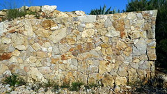 boulder(0.0), soil(0.0), outcrop(0.0), ruins(0.0), bedrock(0.0), terrain(0.0), quarry(0.0), stone wall(1.0), wall(1.0), rubble(1.0), geology(1.0), rock(1.0),