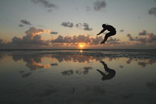 morning summer sky sun holiday reflection beach water sunshine silhouette clouds sunrise tanzania jump wind lagoon acrobat zanzibar breeze reflexions solarwind ebb waterreflection ebbtide jambiani maybemaq the4elements colorphotoaward cosmicwind