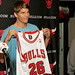 Kyle Korver shows off his number 26 Bulls jersey