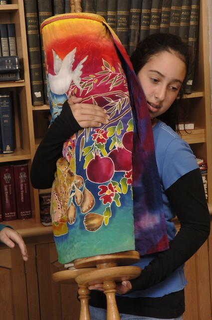 Girl carrying Torah with beautiful cover
