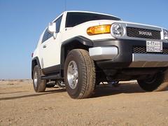 toyota land cruiser(0.0), automobile(1.0), automotive exterior(1.0), toyota(1.0), sport utility vehicle(1.0), wheel(1.0), vehicle(1.0), toyota fj cruiser(1.0), compact sport utility vehicle(1.0), off-roading(1.0), off-road vehicle(1.0), bumper(1.0), land vehicle(1.0),