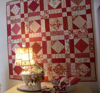 a handmade quilt by jean in yummy reds