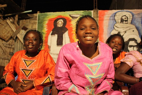 <p>Bebe Diallo, little sister to Maman, smiles along with her school friends, who have planned matching outfits for the night.</p>