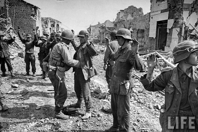 Amidst the ruins of Cisterna, German soldiers being rounded up for transport to confinement areas, by George Silk 1944