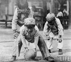 Young Chinese Americans playing football, San Francisco, by E.O. Hoppe 1928