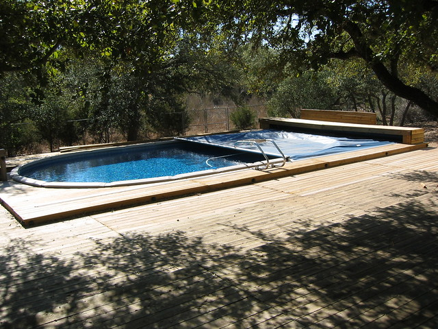 Above ground retractable pool cover bulverde tx flickr photo sharing for Retractable swimming pool covers