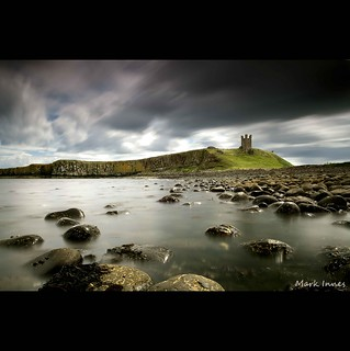 Speedy sky over Dunstanburgh Castle
