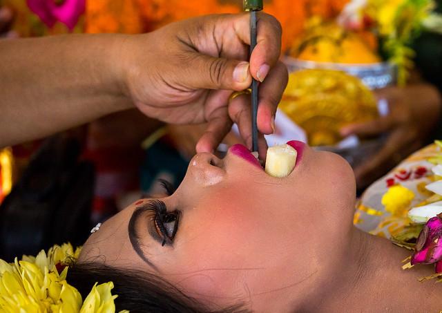 Teenage girl during the tooth filing ceremony, Bali island, Canggu, Indonesia