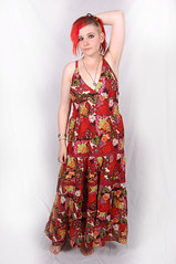 magenta(0.0), sleeve(0.0), sari(0.0), orange(1.0), pattern(1.0), neck(1.0), textile(1.0), gown(1.0), clothing(1.0), red(1.0), cocktail dress(1.0), maroon(1.0), fashion(1.0), formal wear(1.0), fashion design(1.0), photo shoot(1.0), design(1.0), pink(1.0), dress(1.0),