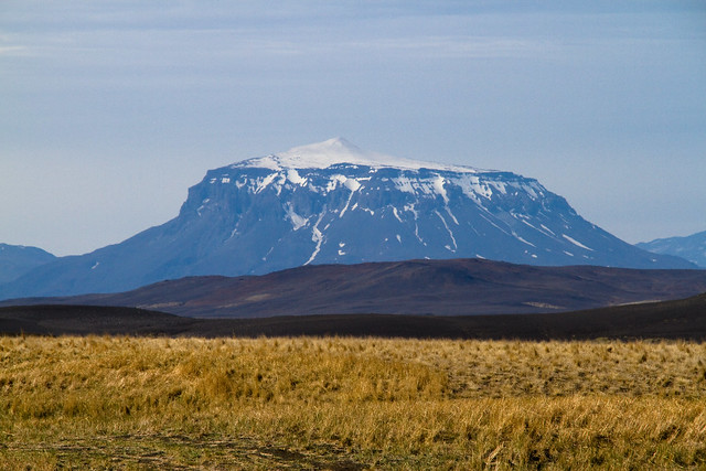 Herðubreið is a tuya in north-east Iceland. It is situated in the Highlands of Iceland in the midst of the Ódáðahraun desert and close to Askja volcano. The desert is a large lava field originating from eruptions of Trölladyngja. Herðubreið originally sat beneath Vatnajökull glacier, which was much larger during the last ice age.  Due to the mountain's steep and unstable sides, the first ascent was in 1908 despite centuries of knowledge of its existence.[citation needed]  Near the mountain lies an oasis called Herðubreiðarlindir with a campground and hiking trails. In former times, outcasts who had been excluded from Icelandic society because of crimes they had committed lived at the oasis.