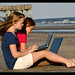 Small photo of Homework on the beach