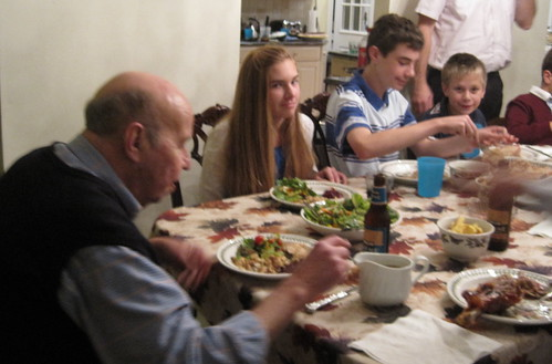 Zaide at Thanksgiving with his grandchildren, sitting at the head of my family table each year and saying a blessing for world peace (see description below).