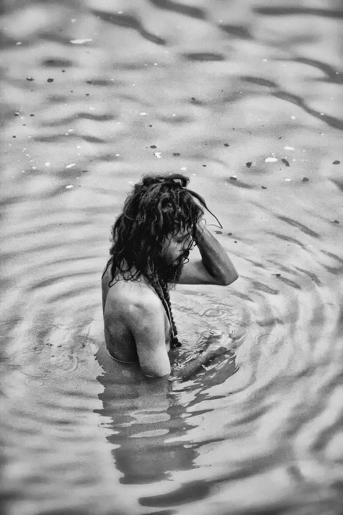 A Saddhu Bathes In The Ganga River