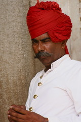 dastar(0.0), cap(0.0), clothing(1.0), red(1.0), man(1.0), hair(1.0), turban(1.0), person(1.0),