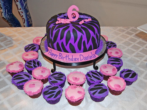 Purple Zebra and Pink Cheetah Cake and Cupcakes for a 6 Birthday