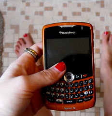 A woman holding her blackberry