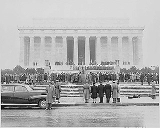 President Truman and his party, including Mrs. Bess Truman, attend the ceremony at the Lincoln Memorial for the birthday of President Lincoln. The group is seen from behind, facing the Lincoln Memorial., 02/12/1948