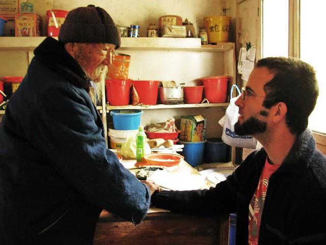 Dr. Ho diagnoses Todd's problem - Baisha, near Lijiang, China