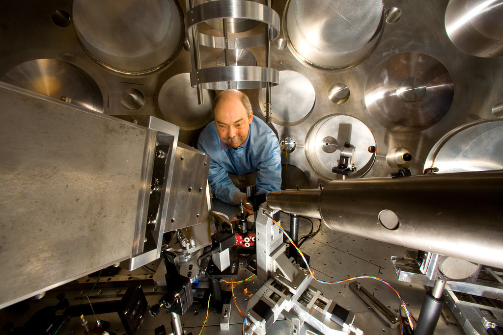 Tom Hurry of Plasma Physics adjusts the target positioner and particle beam diagnostics prior to an experiment at Trident.