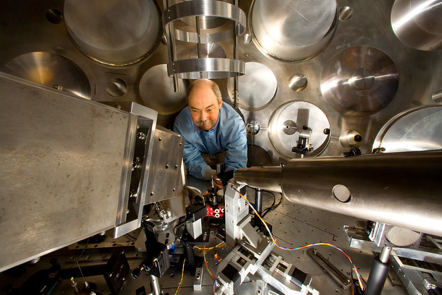 Tom Hurry of Plasma Physics adjusts the target positioner and particle beam diagnostics prior to an experiment at Trident. LANL scientists use Trident to create and study extreme states of matter, such as plasma, by shining a brief, intense pulse of light onto a solid target, which heats a small volume of material into a million-degree microplasma. The laser can produce 500 times the electrical power output of the United States in 500 quadrillionths of a second.   Photo by LeRoy Sanchez.