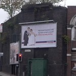 Unused railway viaduct from Liverpool Street, Digbeth - Public toilets at the corner of Great Barr Street / Liverpool Street - Nationwide billboard