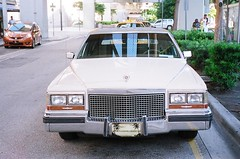 automobile(1.0), automotive exterior(1.0), cadillac(1.0), vehicle(1.0), cadillac brougham(1.0), antique car(1.0), land vehicle(1.0), luxury vehicle(1.0),