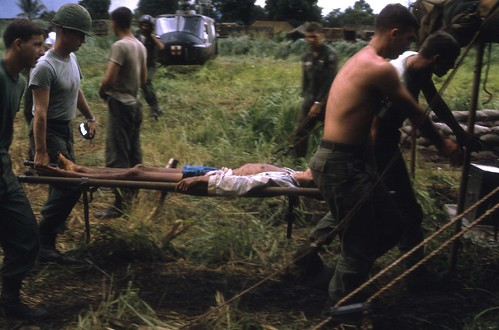 Soldiers from the 173rd Airborne treating a Vietnamese patient at their Medical Platoon, Bien Hoa, Vietnam 1966 by Dr James Hughes by 7th Surgical Hospital (MA)  Vietnam