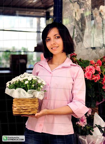 small business owner: woman and her flower shop by mauricio jordan