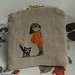 girl and cat purse