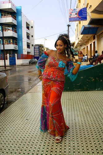 <p>Oumou Sow is famous on the streets of her traditional artisinal neighborhood of Medina, Dakar, which have been washed clean here during the September rainy season.</p>