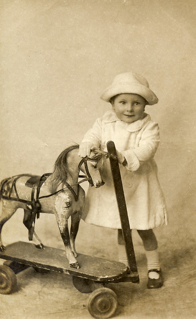 Child with a toy horse in 1912