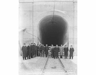 Great Northern Railway and A. Guthrie Co. officials at the entrance to the Cascade Tunnel, the longest tunnel in America (7.8 miles)