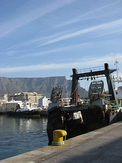 Fishing boats in Cape Town harbour, South Africa, with Table Mountain as backdrop. / Credit:Servaas van den Bosch/IPS