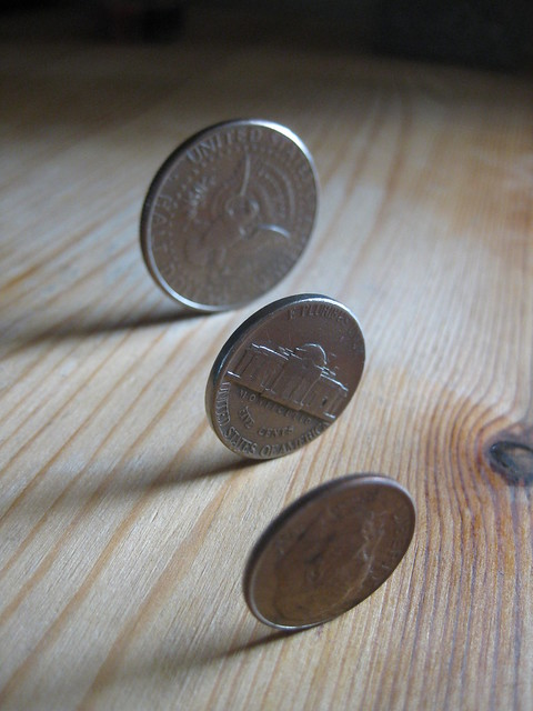Coins Standing, by Michael Ocampo