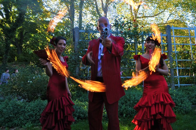 Stephen Ringold twirls his fire umbrella with the Chile Sisters. Photo by Michael Ratliff.