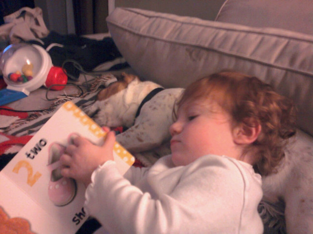 Reading bedtime stories to her puppy.