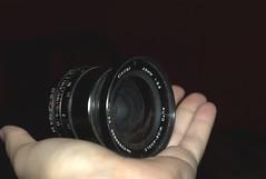 digital camera(0.0), camera(0.0), single lens reflex camera(0.0), digital slr(0.0), fisheye lens(0.0), reflex camera(0.0), hand(1.0), cameras & optics(1.0), mirrorless interchangeable-lens camera(1.0), lens(1.0), close-up(1.0), camera lens(1.0), black(1.0),