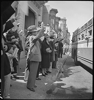 San Francisco, California. Inhabitants of the Japanese section wave farwell at the departure of the . . ., 04/19/1942