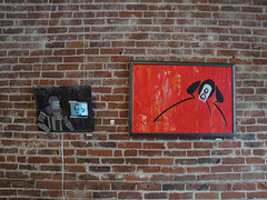 window(0.0), street art(0.0), number(0.0), graffiti(0.0), lane(0.0), road surface(0.0), street(0.0), art(1.0), wall(1.0), red(1.0), brick(1.0), brickwork(1.0),