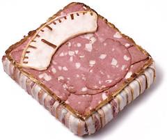kielbasa(0.0), sausage(1.0), capicola(1.0), ham(1.0), bologna sausage(1.0), food(1.0), dish(1.0), cuisine(1.0), pink(1.0), animal fat(1.0),