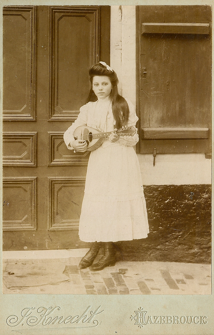 A french girl plays  her mandolin  antique cabinet photo