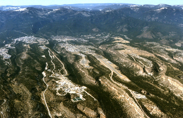 High southwest aerial view of  Los Alamos National Laboratory (left) and Los Alamos townsite (middle and right).
